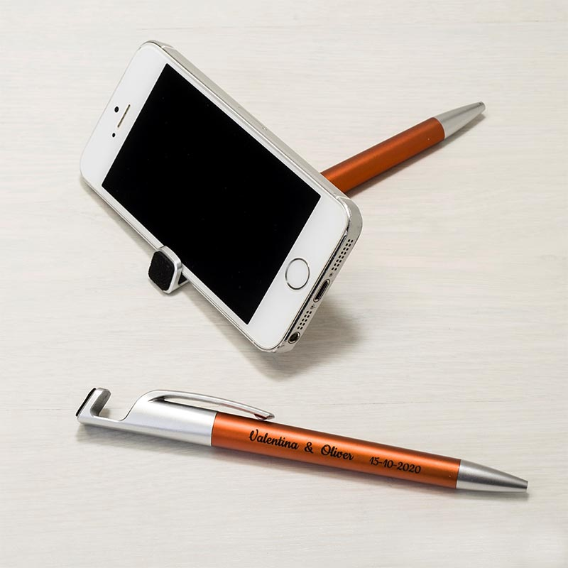 Bolígrafo soporta móvil. Borra huellas. Personalizado. Color ocre.