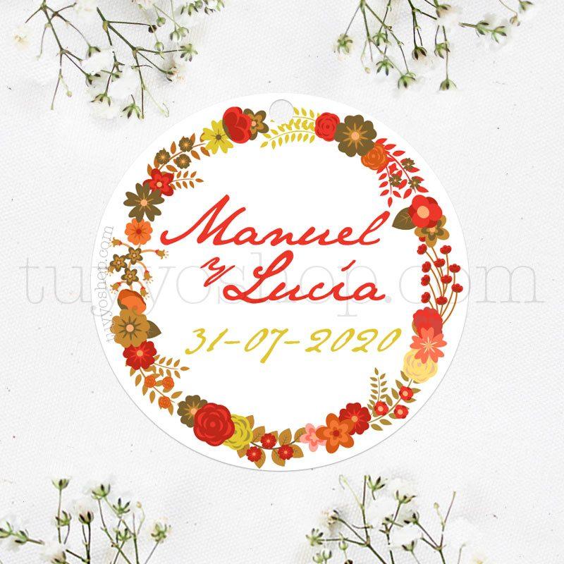 Una elegante etiqueta con diseño floral, compuesta por tonos rojos y anaranjados.