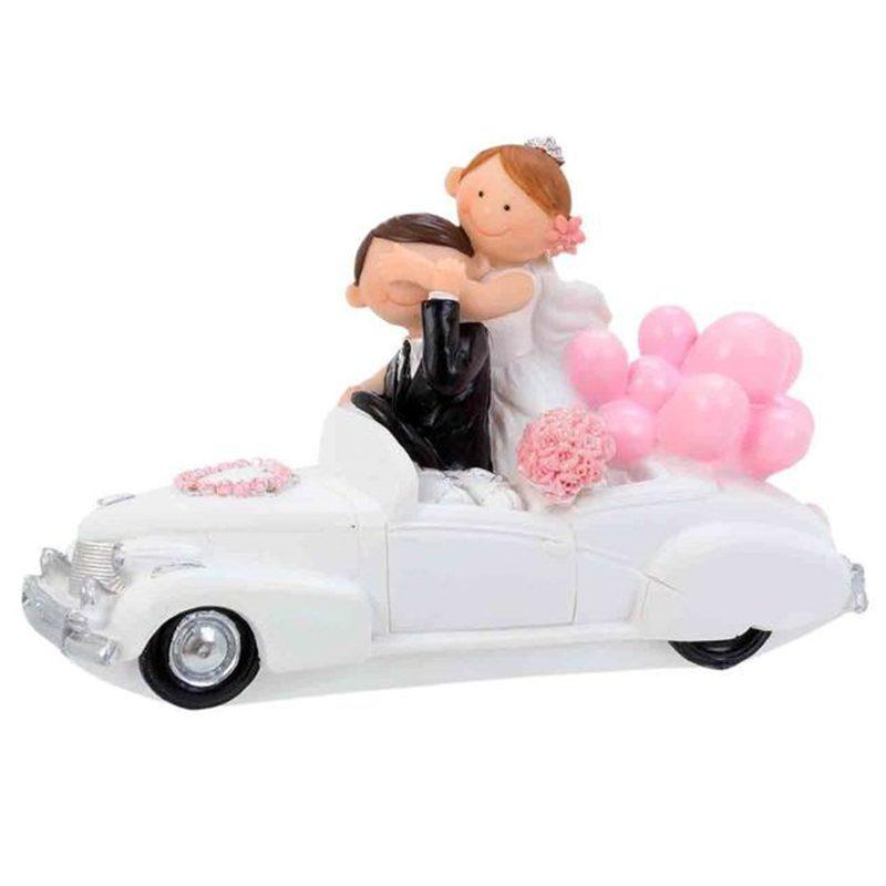 Figura para pastel de boda. Modelo novios en coche. 15.5x6x10cm figura para pastel de boda modelo novios en coche 15