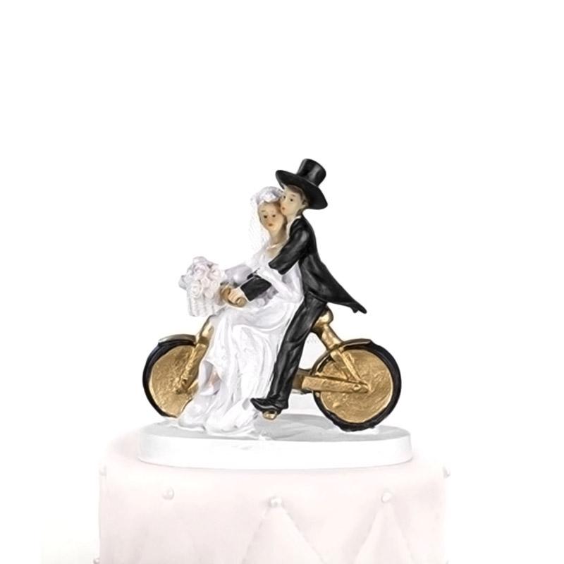 Figura para tarta de boda. Novios en bici.