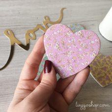 Lima de uñas modelo corazón floral