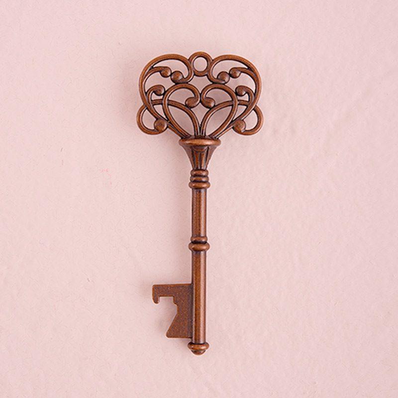 llave abridor vintage bronce con tarjeta kraft