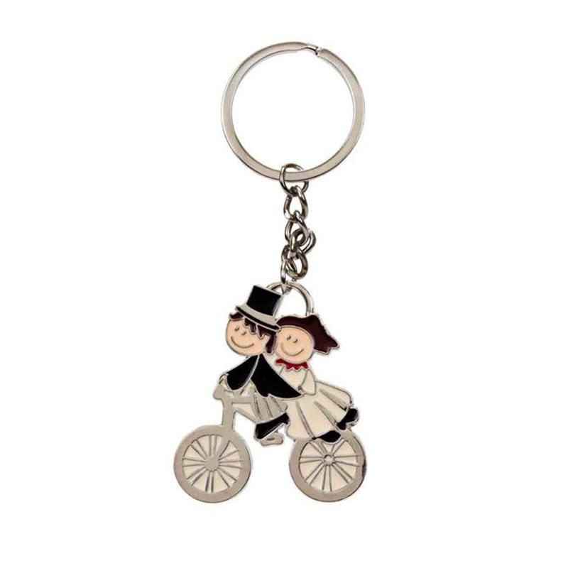 Llavero para regalo. Pareja en bicicleta.