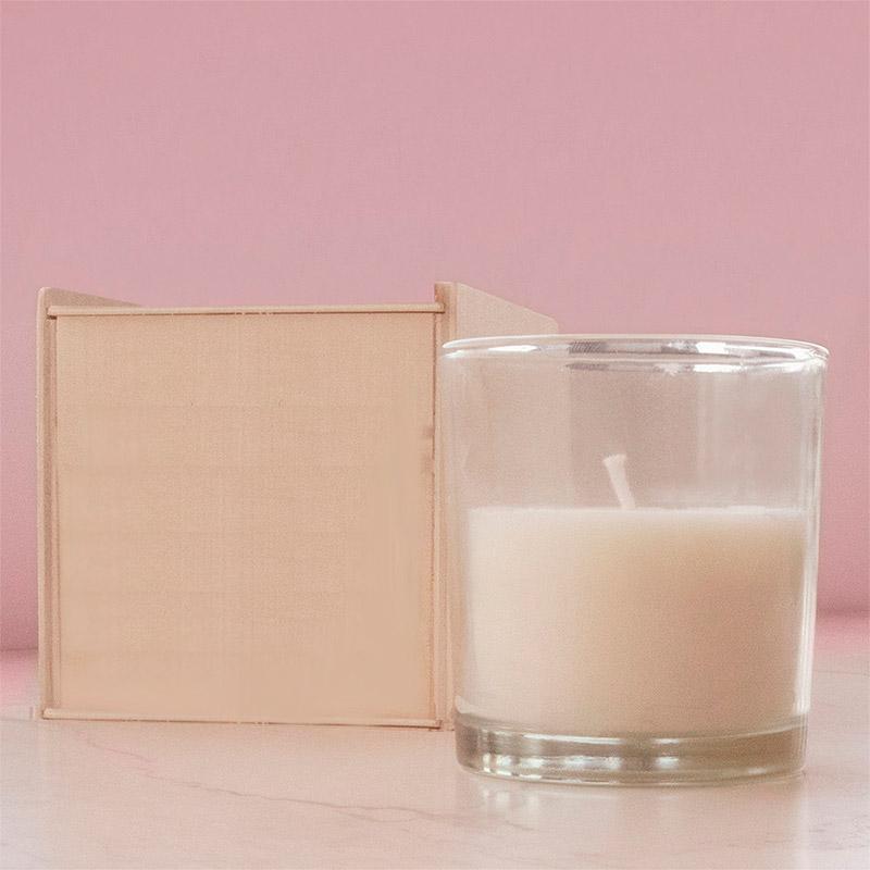vela aromática presentada en caja de madera